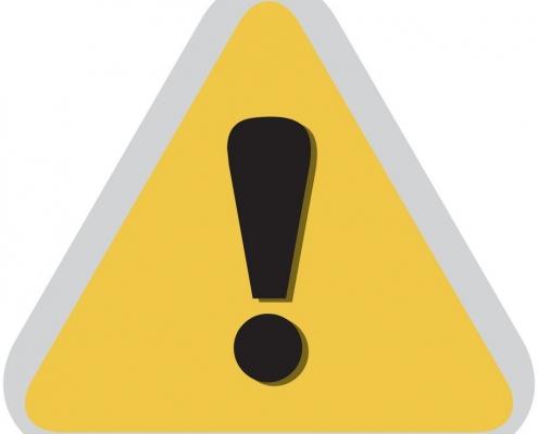 segnale di pericolo a sfondo giallo